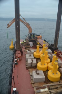 Yellow NN1400 navigation buoys being deployed