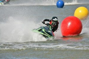 Jetski racing past coloured race markers