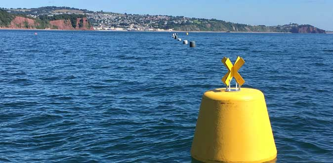 Yellow NN1100 buoy manufactured by Norfloat International for shellfish farm